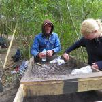 CAS Board Member, Warren McMaster III sifting for finds with UoB student, Leanne Bayliss.