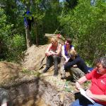 Professor Mark Horton charting and documenting a trench with UoB students.