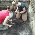 2 UoB students working in the trenches.