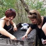 Lead UoB Graduate student, Charlie Goudge (right), with Johanna McCaughey (left), sifting for finds.